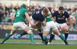 DUBLIN, IRELAND - FEBRUARY 02:  David Denton of Scotland is tackled by Cian Healy during the RBS Six Nations match between Ireland and Scotland at the Aviva Stadium on February 2, 2014 in Dublin, Ireland.  (Photo by David Rogers/Getty Images)