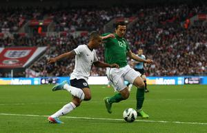 Republic of Ireland's Stephen Kelly (right) and England's Theo Walcott (left) battle for the ball during the International Friendly match at Wembley Stadium, London. PRESS ASSOCIATION Photo. Picture date: Wednesday May 29, 2013. See PA story SOCCER England. Photo credit should read: Nick Potts/PA Wire. RESTRICTIONS: Use subject to FA restrictions. Editorial use only. Commercial use only with prior written consent of the FA. No editing except cropping. Call +44 (0)1158 447447 or see www.paphotos.com/info/ for full restrictions and further information.