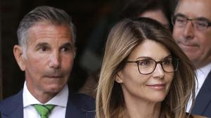 Actress Lori Loughlin and her husband, clothing designer Mossimo Giannulli, seen here at a court in Boston last year. The couple and other prominent parents have told a judge he should dismiss charges against them in the college admissions bribery case (Steven Senne/AP)