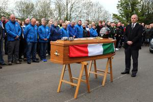 PACEMAKER, BELFAST, 27/4/2017: The gloves and helmet sit on the coffin of Italian rider Dario Cecconi during a service at the start line on theTandragee 100 circuit in Co Armagh in his memory following his death in a crash at last Saturday's races. PICTURE BY STEPHEN DAVISON