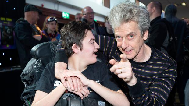 Peter Capaldi at the 2019 Capital Sci Fi Con with Adam Meldrum who receives CHAS care in Kinross (Lesley Martin/CHAS/PA)