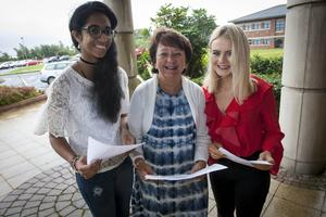 Mrs. Marguerite Hamilton, Principal, Thornhill College, Derry pictured with Blessy Biji and Emer Mulholland who both got 3A*s in this year's results.