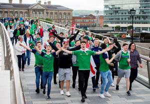 Northern Ireland fans cross the Lagan Weir Foot Bridge in Belfast, enroute to the Titanic Fanzone to watch Northern Ireland V Germany in Euro 2016. PRESS ASSOCIATION Photo. Picture date: Tuesday June 21, 2016. Photo credit should read: Liam McBurney/PA Wire