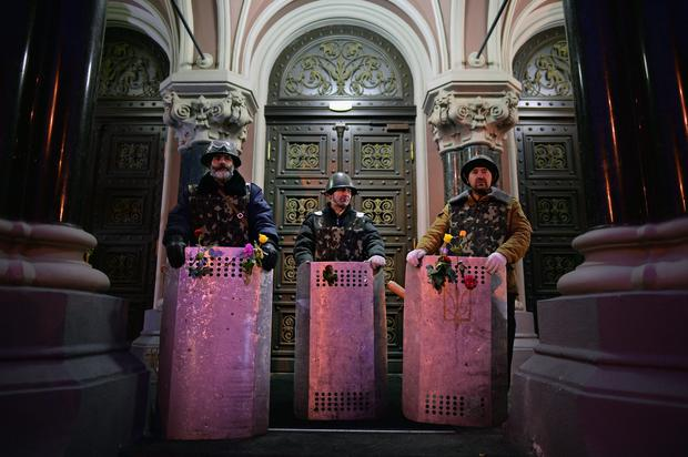 Anti-government demonstrators guard government building near to Independence Square on February 23, 2014 in Kiev, Ukraine. Prime Minister Yanukovych is said to have left Kiev for a eastern stronghold as the country's parliament voted to remove Yanukovych from office and call for new elections.  Photo by Jeff J Mitchell/Getty Images