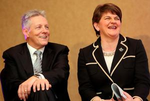 Former Democratic Unionist Party (DUP) leader Peter Robinson (L) shares a joke with the new leader Arlene Foster, Northern Ireland Finance Minister in Belfast after the leadership contest on December 17, 2015. A special electoral college will gather at the hotel, and Foster is the only candidate for the leadership. Foster will replace Peter Robinson following his announcement that he will step down as Northern Ireland's First Minister and as leader of the DUP.  AFP PHOTO / PAUL FAITHPAUL FAITH/AFP/Getty Images