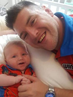 Daryl at the double: Doting dad and recently crowned Players' Championship winner Daryl Gurney with his son, Daryl Jnr