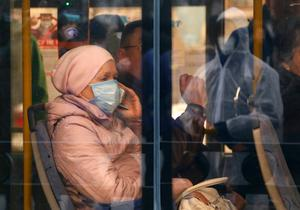 Ukrainians wearing face masks sit on a public bus in Kyiv, Ukraine, Tuesday, March 17, 2020 (AP Photo/Efrem Lukatsky)