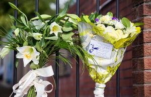 Floral tributes left at the gates of Connolly House, Andersonstown, Belfast following the death of Northern Ireland's former deputy first minister and ex-IRA commander Martin McGuinness aged 66.  Liam McBurney/PA Wire