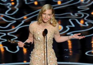 Actress Cate Blanchett accepts the Best Performance by an Actress in a Leading Role award for 'Blue Jasmine' onstage during the Oscars at the Dolby Theatre on March 2, 2014 in Hollywood, California.  (Photo by Kevin Winter/Getty Images)