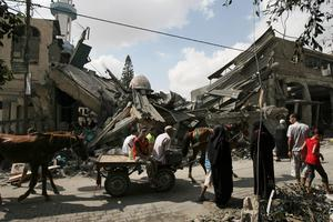 Palestinians inspect the Al Farouk mosque which was destroyed by an overnight Israeli strike, in Rafah, in the southern Gaza Strip, Tuesday, July 22, 2014.  (AP Photo/Eyad Baba)