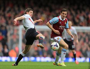 West Ham United's Stewart Downing (right) and Liverpool's Steven Gerrard (left) battle for the ball during the Barclays Premier League match at Upton Park, London.