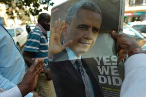 A Kenyan reads a local newspaper pullout depicting American President Barack Obama and the President-elect, on January 20, 2017 in the streets of Nairobi.   Donald J. Trump was elected as the President of the United States on November 8, 2016, and will take the oath of office on January 20, 2017, to formally become the 45th President of the United States. / AFP PHOTO / SIMON MAINASIMON MAINA/AFP/Getty Images