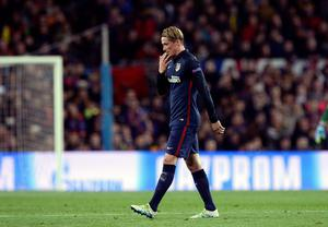 Atletico Madrid's forward Fernando Torres leaves the field after being sent off during the UEFA Champions League quarter finals first leg football match FC Barcelona vs Atletico de Madrid at the Camp Nou stadium in Barcelona on April 5, 2016. / AFP PHOTO / JOSEP LAGOJOSEP LAGO/AFP/Getty Images