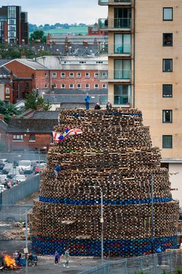 BELFAST, NORTHERN IRELAND - JULY 10:  The bonfires also mark the beginning of the annual 12th of July Orange parades.  (Photo by Jeff J Mitchell/Getty Images)