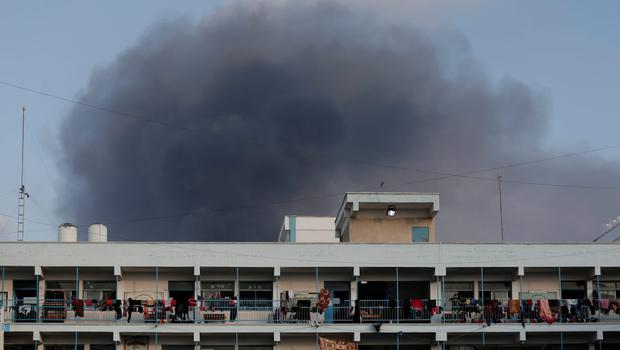Smoke from the explosion of an Israeli strike rises over a UN school at Jebaliya refugee camp, in the northern Gaza Strip, where Palestinian displaced people had found refuge, on Tuesday, July 29, 2014. (AP Photo/Lefteris Pitarakis)