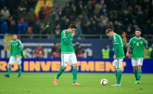 Northern Ireland's Kyle Lafferty (left) Billy McKay (centre) and Oliver Norwood look dejected after Romania score their second goal of the game during the UEFA Euro 2016 qualifier at the Arena Nationala, Bucharest. Nick Potts/PA Wire.