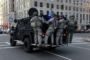 BOSTON, MA - APRIL 15:  A swat team arrives at the corner of Stuart Street and Dartmouth Street after two explosive devices detonated at the finish line of the 117th Boston Marathon on April 15, 2013 in Boston, Massachusetts. Two people are confirmed dead and at least 23 injured after two explosions went off near the finish line to the marathon.