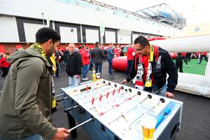 LIVERPOOL, ENGLAND - APRIL 14:  Fans play Table Football prior to the UEFA Europa League quarter final, second leg match between Liverpool and Borussia Dortmund at Anfield on April 14, 2016 in Liverpool, United Kingdom.  (Photo by Clive Brunskill/Getty Images)