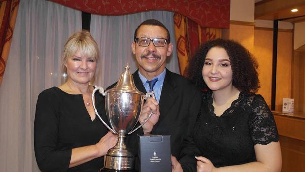 Honour: Alan Gracey, wife Jacqui and daughter Leah with his Ivan Marshall Special Merit award for services to Mid Ulster football