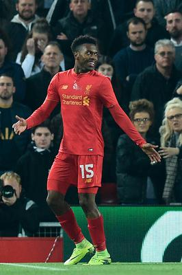 Liverpool's English striker Daniel Sturridge celebrates after scoring the opening goal of the EFL (English Football League) Cup fourth round match between Liverpool and Tottenham Hotspur at Anfield in Liverpool north west England on October 25, 2016. / AFP PHOTO / Oli SCARFF / RESTRICTED TO EDITORIAL USE. No use with unauthorized audio, video, data, fixture lists, club/league logos or 'live' services. Online in-match use limited to 75 images, no video emulation. No use in betting, games or single club/league/player publications.  / OLI SCARFF/AFP/Getty Images