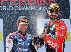 PHILLIP ISLAND, AUSTRALIA - FEBRUARY 23:  Eugene Laverty (L) of Ireland and Voltcom Crescent Suzuki along with Sylvain Guintoli of France and Aprilia Racing Team spray champagne on the winners podium after race 1 during round one of the 2014 World Superbike Championship at Phillip Island Grand Prix Circuit on February 23, 2014 in Phillip Island, Australia.  (Photo by Scott Barbour/Getty Images)