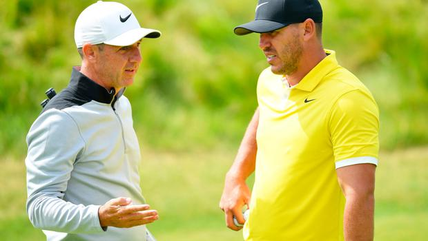 PORTRUSH, NORTHERN IRELAND - JULY 15: Brooks Koepka of the United States and caddie Ricky Elliott speak during a practice round prior to the 148th Open Championship held on the Dunluce Links at Royal Portrush Golf Club on July 15, 2019 in Portrush, United Kingdom. (Photo by Stuart Franklin/Getty Images)