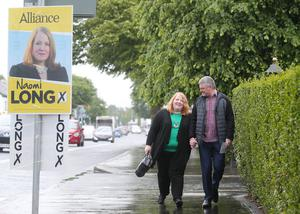 Alliance Party leader and East Belfast candidate Naomi Long and her husband Michael pictured at St Colmcilles Parish Church in east Belfast where they cast their vote. Picture by Jonathan Porter/PressEye.com