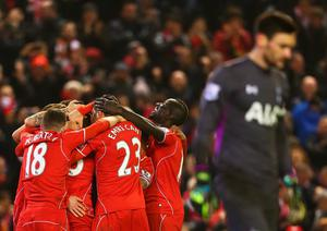 Liverpool players celebrate the goal scored by Mario Balotelli during the Barclays Premier League match between Liverpool and Tottenham Hotspur at Anfield on February 10, 2015 in Liverpool, England.  (Photo by Clive Brunskill/Getty Images)