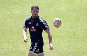 HONG KONG - MAY 31:  Alex Cuthbert passes the ball during the British and Irish Lions captain's run at the Aberdeen Sports Ground on May 31, 2013 in Hong Kong.  (Photo by David Rogers/Getty Images)