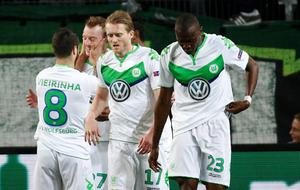 Wolfsburg's players celebrate after midfielder Maximilian Arnold (2nd L) scored the 2-0 goal during the UEFA Champions League quarter-final, first-leg football match between VfL Wolfsburg and Real Madrid on April 6, 2016 in Wolfsburg, northern Germany.  / AFP PHOTO / ODD ANDERSENODD ANDERSEN/AFP/Getty Images