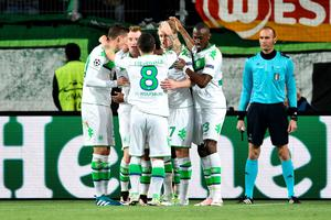 WOLFSBURG, GERMANY - APRIL 06:  Maximilian Arnold (2nd L) of Wolfsburg celebrates scoring his team's second goal with his team mates during the UEFA Champions League Quarter Final First Leg match between VfL Wolfsburg and Real Madrid at Volkswagen Arena on April 6, 2016 in Wolfsburg, Germany.  (Photo by Stuart Franklin/Bongarts/Getty Images)