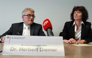 Federal state attorney Herbert Diemer (L) and state attorney Anette Greger address the media during a press conference at the Oberlandesgericht Muenchen state court building on the first day of the NSU neo-Nazi murder trial on May 6, 2013 in Munich, Germany.