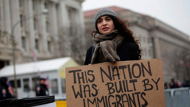 A woman holds a sign before the start of the Presidential Inauguration of Donald Trump at Freedom Plaza on January 20, 2017 in Washington, DC. Donald Trump will be sworn in as the 45th president of the United States Friday -- capping his improbable journey to the White House and beginning a four-year term that promises to shake up Washington and the world. / AFP PHOTO / Joshua LOTTJOSHUA LOTT/AFP/Getty Images