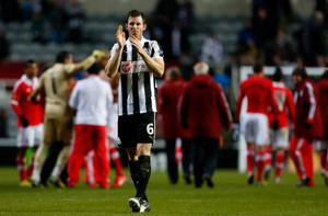 NEWCASTLE, ENGLAND - APRIL 11: Mike Williamson of Newcastle applauds the home fans after the UEFA Europa League quarter final second leg match between Newcastle United and SL Benfica at St James' Park on April 11, 2013 in Newcastle upon Tyne, England. (Photo by Paul Thomas/Getty Images)