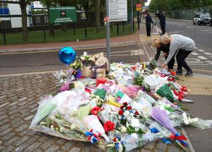 Two women lay flowers outside the Royal Artillery Barracks in Woolwich as anti-terror police were today preparing to question the two men shot and injured after the Woolwich soldier killing as details about their backgrounds began to emerge. PRESS ASSOCIATION Photo. Picture date: Thursday May 23, 2013. See PA story POLICE Woolwich. Photo credit should read: Max Nash/PA Wire