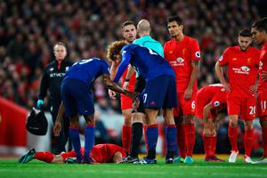 James Milner of Liverpool lies on the ground injured during the Premier League match between Liverpool and Manchester United at Anfield on October 17, 2016 in Liverpool, England.  (Photo by Clive Brunskill/Getty Images)