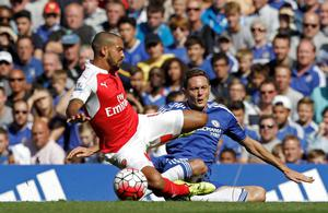 Chelsea's Serbian midfielder Nemanja Matic (R) vies with Arsenal's English midfielder Theo Walcott (L) during the English Premier League football match between Chelsea and Arsenal at Stamford Bridge in London on September 19, 2015. AFP PHOTO / IAN KINGTON   RESTRICTED TO EDITORIAL USE. No use with unauthorized audio, video, data, fixture lists, club/league logos or 'live' services. Online in-match use limited to 75 images, no video emulation. No use in betting, games or single club/league/player publications.IAN KINGTON/AFP/Getty Images
