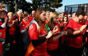 PARIS, FRANCE - OCTOBER 16:  Munster fans sing the Munster anthem, The Fields of Anthenry as a mark of respect after hearing of the news of the death of Munster coach Anthony Foley prior to the European Rugby Champions Cup match between Racing 92 and Munster at Stade Yves-Du-Manoir on October 16, 2016 in Paris, France.  (Photo by David Rogers/Getty Images)