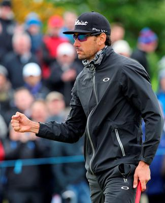 Rafa Cabrera-Bello of Spain celebrates a putt on the 16th hole on the third day of the Irish Open at the Royal County Down Golf Club in Newcastle in Northern Ireland on May 30, 2015.      AFP PHOTO / PAUL FAITHPAUL FAITH/AFP/Getty Images