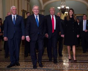 President-elect Donald Trump, his wife Melania, and Vice President-elect Mike Pence, walk with Senate Majority Leader Mitch McConnell of Ky.,  on Capitol Hill Thursday, Nov. 10, 2016. (AP Photo/Molly Riley)