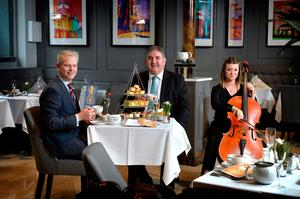 Ulster Orchestra cellist Rosalie Curlett entertains Ten Square Hotel manager Stephen Perry and Peter Jackson of JTI over afternoon tea in the hotel's Linen Lounge