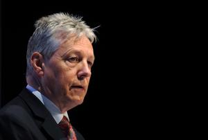 Peter Robinson has called-off his trip to Brazil over fears of trouble during summer loyalist marching season