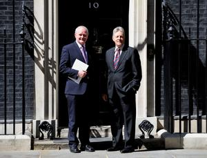 Northern Ireland First Minister Peter  Robinson (right) and Deputy First Minister Martin McGuinness leave 10 Downing Street following a meeting with Prime Minister David Cameron, to sign off an economic package for NI in advance of the G8 summit. PRESS ASSOCIATION Photo. Picture date: Friday June 14, 2013. See PA story ULSTER Economy. Photo credit should read: Nick Ansell/PA Wire