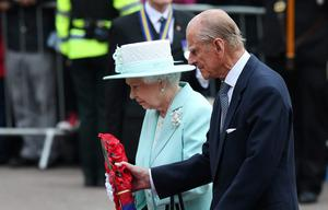 Queen Elizabeth II and Prince Philip, Duke of Edinburgh carry a wreath during a service at the war memorial on June 25, 2014 in Coleraine. Pic Peter Macdiarmid/Getty Images