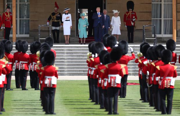 Back inside the palace grounds, the visitors and their royal hosts inspected the Guard of Honour (Toby Melville/PA)
