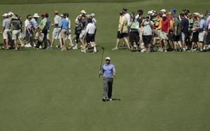 Rory McIlroy, of Northern Ireland, walks down the seventh fairway during a practice round for the Masters golf tournament Tuesday, April 9, 2013, in Augusta, Ga. (AP Photo/Charlie Riedel)