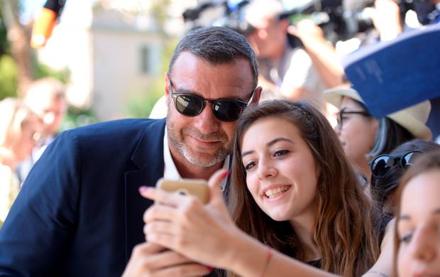 "Actor Liev Schreiber poses with fans as he arrives for the photocall of the movie ""The Bleeder"" presented out of competition at the 73rd Venice Film Festival on September 2, 2016 at Venice Lido.FILIPPO MONTEFORTE/AFP/Getty Images"