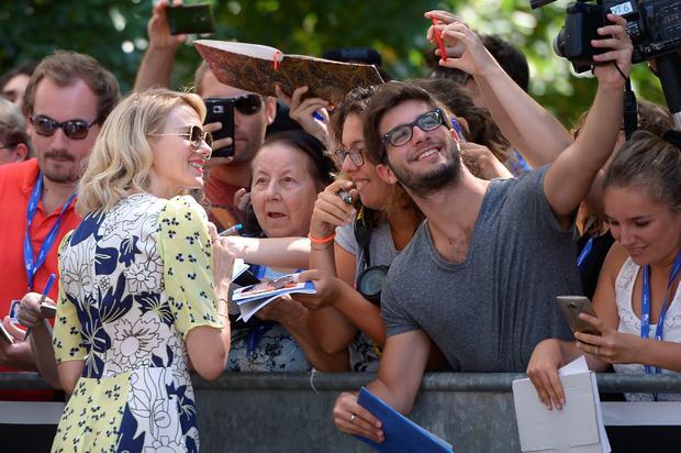"Actress Naomi Watts  poses with fans as she arrives for the photocall of the movie ""The Bleeder"" presented out of competition at the 73rd Venice Film Festival on September 2, 2016 at Venice Lido.FILIPPO MONTEFORTE/AFP/Getty Images"