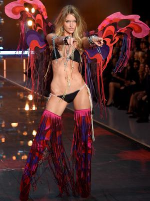 NEW YORK, NY - NOVEMBER 10:  Model and new Victoria's Secret Angel Martha Hunt from North Carolina walks the runway during the 2015 Victoria's Secret Fashion Show at Lexington Avenue Armory on November 10, 2015 in New York City.  (Photo by Dimitrios Kambouris/Getty Images for Victoria's Secret)