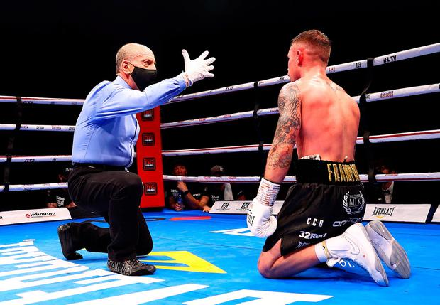 DUBAI, UNITED ARAB EMIRATES - APRIL 03: The referee counts down Carl Frampton of Northern Ireland after being knocked down during the WBO World Super Featherweight Title Fight between Jamel Herring and Carl Frampton at The Rotunda at Caesars Palace on April 03, 2021 in Dubai, United Arab Emirates. (Photo by Francois Nel/Getty Images)